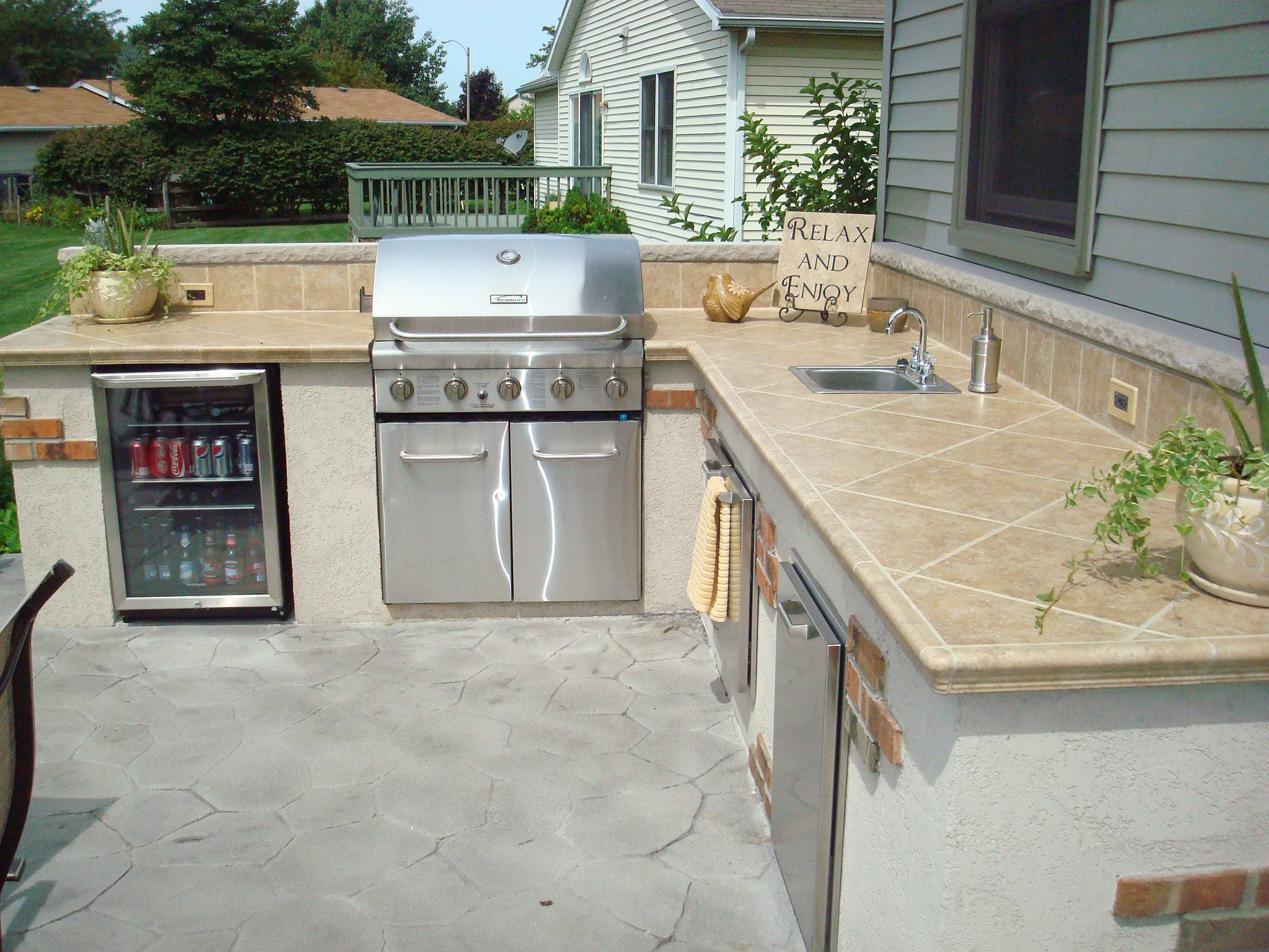 Outdoor living kirk wylie masonry for Outdoor kitchen counter with sink